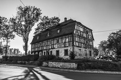 Timbered house (ErrorByPixel) Tags: timbered house timberedhouse pentax k5 pentaxk5 errorbypixel handheld bogatynia lower silesia lowersilesia street trees sun shadows sky powerlines pavement outsidestairs stairs windows roof grass poland dolnyśląsk dolny śląsk architecture chimney blackandwhite black white bnw bw monochrome building pentaxart thebp
