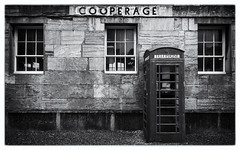 Royal William Yard Call Box. (Go placidly amidst the noise and haste...) Tags: royalwilliamyard royalnavy navy rwy naval historic history phonebox callbox telephonebox kiosk telephonekiosk telephone phone plymouth devon southwest westcountry mono blackandwhite blackwhite silverefex windows window booth phonebooth