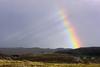 Balchrick Bow (Chris..Miles) Tags: sutherland rainbow balchrick scotland landscape sky squall rain sun