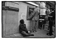 A SHOELESS SITTER AT THE CASH POINT (StockCarPete) Tags: london uk street cashpoint londonstreet shoeless bw londonbw