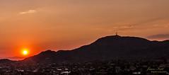 Radiant (Justitia Omnibus) Tags: sunset arizona landscape sun canon phoenix clouds desert light mountains orange usa summer