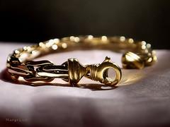 Jewel's Connection ... (MargoLuc) Tags: macromondays theme connection bracelet gold bokeh macro natural window light silk backlight indoor