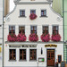 An old house with flowers on the window sills in the central square in Cottbus, Germany