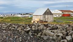 Shed Beyond the Seawall (wyojones) Tags: iceland lighthouse beach grótta seltjarnarnestown reykjavik seltjarnarnespeninsula northatlantic faxaflóibay shed shack rock seawall town wyojones