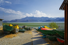 Pick Your Color (Alfred Grupstra) Tags: lake nauticalvessel nature mountain water outdoors landscape scenics vacations sky tranquilscene summer travel blue tourism beach nopeople traveldestinations sea idyllic montenegro skadarlake
