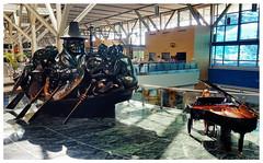 YVR (TravelsWithDan) Tags: thespritofhaidagwaii billreid sculpture pianist piano airport yvr vancouverinternationalairport vancouver bc canada richmond