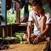Tulsi Gurung helps his wife prepare food.