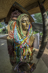 Statue in Chimayo, New Mexico (Tom Kilroy) Tags: chimayomission chimayonewmexico newmexico cultures religion spirituality people indigenousculture travel traveldestinations tourism famousplace outdoors multicolored praying decoration statue rosarybeads