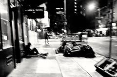O'Farrell and Leavenworth - Tenderloin (draketoulouse) Tags: san francisco sanfrancisco street streetphotography monochrome blackandwhite ofarell leavenworth people blur contrast noise city night texture