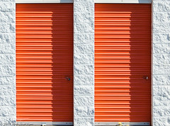 Orange Doors (Jim Frazier) Tags: orange doors storage facility self elgin illinois il kane summer sun sunny september 2017 jimfraziercom urban headon centered centralperspective pov symmetry symmetrical perpendicular linedup abstract clipart f10 fastpictures q3