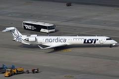 Nordica / LOT Bombardier CRJ-900 ES-ACK (c/n 15211) (Manfred Saitz) Tags: vienna airport schwechat vie loww flughafen wien nordica lot bombardier crj900 crj9 esack esreg