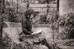 She's reading (ElmerstarK) Tags: bokeh portrait calme reading outdoor quiet nb bw contrast noiretblanc ancien woman old lecture femme blackandwhite exterieur écully rhônealpes france fr
