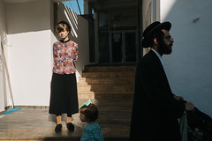 Jerusalem (f.d. walker) Tags: africa israel jerusalem middleeast religion religious jewish judaism ultraorthodox mea shearim hasidic man woman girl child family light streetphotography street sunlight shadow candidphotography candid color clothes colorphotography city children