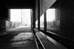tunnel alley (fallsroad) Tags: tulsaoklahoma downtown urban city alley tunnel att building reflection bw blackandwhite monochrome sunset