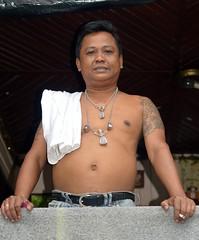 man on a balcony (the foreign photographer - ฝรั่งถ่) Tags: jan92016nikon man cigarette amulets tattoos balcony khlong bang bua portraits bangkhen bangkok thailand nikon d3200