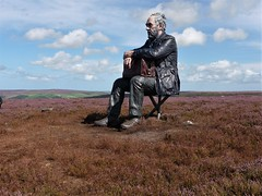 Seated giant walker above Castleton N.Yorks (Martellotower) Tags: seated climber castleton statue moorland north york moors heather sean henry climb