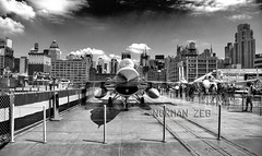 The Fighting Falcon! F16 (9) (a2roland) Tags: fighting falcon nyc new york city norm aircraft carrier plane jet airplane fighter bomber ship aboard museum ny fence platform people buildings skyline bw black white monotone monochrome clouds sky contrast high photo landscape cityscape © norman zeb photography all rights reserved