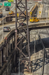 """NYC Street Scene As Seen From Roosevelt Island Tram Atop of Queensboro Bridge Exit Onto 2nd Avenue and 60th St. NYC (nrhodesphotos(the_eye_of_the_moment)) Tags: dsc09223001024 """"theeyeofthemoment21gmailcom"""" """"wwwflickrcomphotostheeyeofthemoment"""" summer2017 season manhattan nyc reflections shadows autos taxis bridge overpass transpiration structure metals beams streetlight tram roads streets ramps outdoors"""