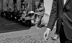 Always someone watching. (Baz 120) Tags: candid candidstreet candidportrait city candidface candidphotography contrast street streetphoto streetcandid streetphotography streetphotograph streetportrait rome roma romepeople romecandid em5 europe mft m43 monochrome monotone mono blackandwhite bw urban voightlander12mmasph life primelens portrait people unposed omd olympus italy italia grittystreetphotography faces decisivemoment strangers