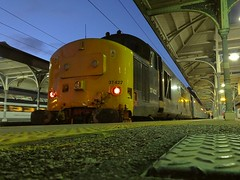 DRS Loco 37422 top n tail with 37425 awaits its next turn of duty,in the twighlight at Norwich Station. 31 12 2015 (pnb511) Tags: diesel loco locomotive train track rails railway class37 station dark lights twighlight canopy platform shortsetgreateranglia drs