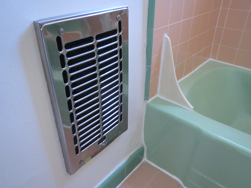 I love this bathroom heater and I love the tile colors in this palce