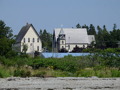 A distant view of the Church of Ascension at North Head seen from Stanley Beach on Grand Manan Island (Bay of Fundy), New Brunswick (Ullysses) Tags: churchoftheascension northhead grandmananisland newbrunswick canada summer été church église anglican