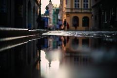 The color of sundown (ewitsoe) Tags: reflection poznan poland erikwitsoe ewitsoe canon reflected alley street urban city blur bokeh cityscape polska curb summer