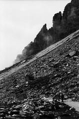 Two Fellow Hikers (Nobusuma) Tags: pentaxmx pentax smcpentax 50mm f17 24x36 135mm agfa agfaapx 100iso italy italia lavaredo trecimedilavaredo hiking hikinglife hikers rocks blackandwhite bw monochrome caffenolcm selfdeveloped film homemadesoup