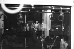 Story untold (Elios.k) Tags: horizontal indoors people many man young stare look mask surgicalmask face japanese suit businessman commuter tram train publictransportation reflection glass blackandwhite bw monochrome night dark travel travelling december 2016 winter vacation canon 5dmkii camera photography chūōku kumamoto kumamotoprefecture kyushu island japan asia