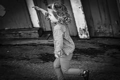 Running girl in Stockholm, Sweden 7/8 2017. (photoola) Tags: stockholm skansen barn sv djurgården girl child kids monochrome blackandwhite street photoola