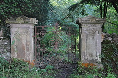 What lies beyond? (katy1279) Tags: gate overgrown unknown greenery gateposts