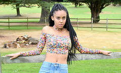 Holding on. (pstone646) Tags: portrait pretty beauty youngwoman younglady people outdoors parkland browneyes longhair bellybutton jeans