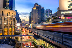 The Bangkok Skytrain (YuriFineart) Tags: bangkok thailand asia skytrain city cityscape streetphotography streets architecture skyscrapers rails building night citylights bluehour urban design cities perspective angle beautiful lines leadinglines travel travelphotography traveling transportation busy alive