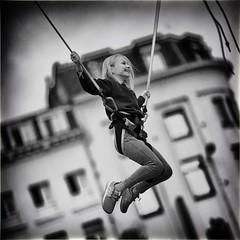 Bungee Jump (Fouquier ॐ) Tags: blackandwhite bw street people girl fair jump fun bungee