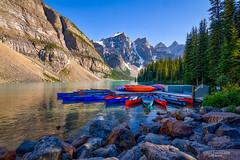 Canoes at Moraine Lake (Greg Lundgren Photography) Tags: morainelake canoe alberta canada banff nationalpark rockymountainscanadianrockiestravelvacationroadtripbluerocksnatureglaciermountainslake