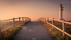 walking at the  lighthouse (Raul Piki Bolukua) Tags: faro sunset sun sky goldenhour gold lighthouse summer light exposure sea water landscape cantabria spain camino wood road yellow colors