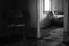 Dark Matters. (Fistfulofpowder) Tags: rurex abandoned alberta canada chair couch door window floor wood quiet creepy nikon d300s black white bw mono monochrome nikkor f18 prime fixed lens dof depth field shallow blackandwhite natural light 35mm dx blur old house art derelict urban explorer exploring contrast forgotten thephotoargus