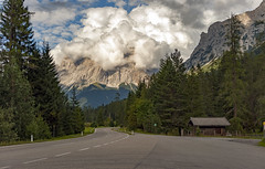 Road to the Hidden Mountain (Frags of Life) Tags: zugspitze austria beautyinnature cloudsky colourimage day alps road trees shed mountain mountainrange germanalps