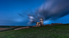Blue hour at the lighthouse (Valentin Laurentziu) Tags: landscape eastbourne beachy head lighthouse sky skyline longexposure blue hour clouds green movement summer