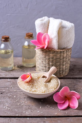 Spa or wellness setting. (ynottri) Tags: salt sea aroma aromatic spa wellness stilllife natural nature oil bottle vintage wooden plumeria grey textured flower background towel table white yellow bowl ceramic althernative aromatherapy bath beauty body care cosmetic essential fresh home hygiene light marine medicine moistirising nobody products relaxation rustic shower therapy treatment lifestyle organic relax recreation smell seasalt image photo