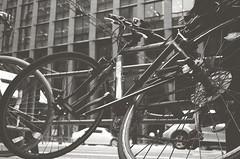 Second (Yosh the Fishhead) Tags: olympus olympus35dc 35dc 40mm film bw blackwhite blackandwhite monochrome foma fomapan200 pushprocess pushprocessed tokyo japan bike bicycle wheel dof bokeh street