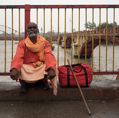 Sadhu in Haridwar (avati91) Tags: sadhu baba hindu india gange river haridwar religion hinduism zuiko 17 17mm 18 olympus omd street portrait orange red ganga harti