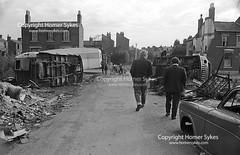 Irish tinkers scrap metal car dealers Balsall Heath Birmingham Gypsy camp site 1968 1960s England (Homer Sykes) Tags: birmingham balsallheath innercity gypsy gypsies encampment campsite irish tinkers poverty poor britishsociety 1960s 60s archivestock 1968 britain england uk british english gbr