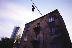 Hanged out shoes (Analog World Thru My Lenses) Tags: nikonfa zoomnikkor3570mmf35 kodakcolor200 june 2017 warszawa warsaw spire wola shoes converse