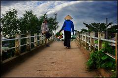 The Young Smoker (bit ramone) Tags: smoker bridge puente vietnam mekong delta bitramone fumador sombrero woman mujer joven young