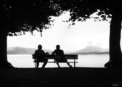 generation talk on the lakeside (René Mollet) Tags: lake lakefront lakeside talk generation lakezug zugersee silhouette shadow streetart street streetphotography urban renémollet urbanstreet urbanlife morning candle blackandwhite bw frame penf people young oldman