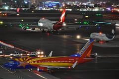 Midnight Rush (Rich Snyder--Jetarazzi Photography) Tags: qantas qfa qf boeing 747 747400er 747438er b747 b744 vhoei aeromexico amx am 737 737800 73781q b737 b738 n520am southwestairlines southwest swa wn 737300 7373h4 b733 n383sw speciallivery specialscheme arizonaone departure departing arrival arriving sanfranciscointernationalairport sfo ksfo millbrae california ca airplane airliner aircraft jet plane jetliner ramptowera rcta atower dark night lights traffic jumbojet