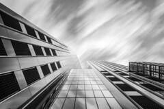 Towards a streaming sky mono (frank_w_aus_l) Tags: rotterdam sky skyscraper longexposure architecture netherlands nikon d7000 monochrome sw netb windows city fineart zuidholland niederlande nl