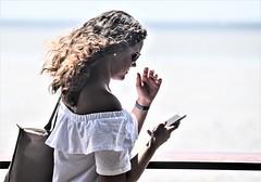 whatsapping ----- DSC_5921_ (2) (harry de haan, the cameraman) Tags: harrydehaan whatsapping cairns esplanade fnq australia tropical communicating beingsocial documentaryphotography people phones queensland fotosdieietstevertellenhebben storytelling