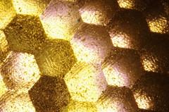 LED Lens (erluko) Tags: golden multifaceted facets bulb lamp illumination speck surface r14 e17 polycarbonate ledare lens extrememacro details glass macro reverselensmacro led light texture ikea hexagon abstractmacro